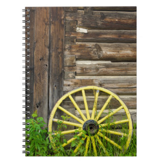 Old wagon wheel in historic old gold town spiral notebook