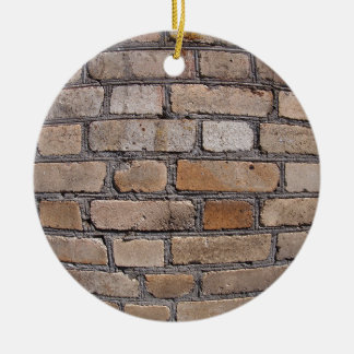 Old wall from gray and brown bricks round ceramic decoration