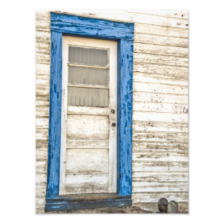Old weathered door with a blue frame photo print
