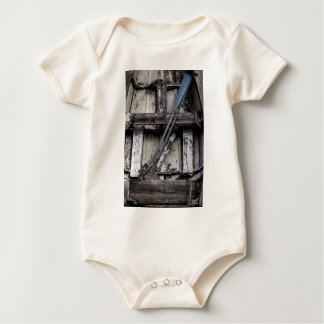 Old weathered row boat. baby bodysuit