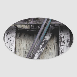 Old weathered row boat. oval sticker