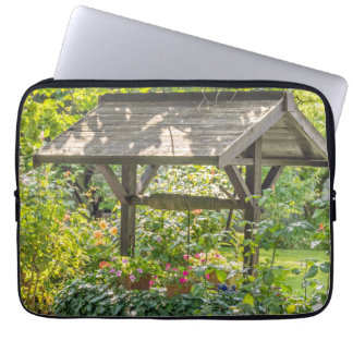 Old well in a garden laptop sleeve