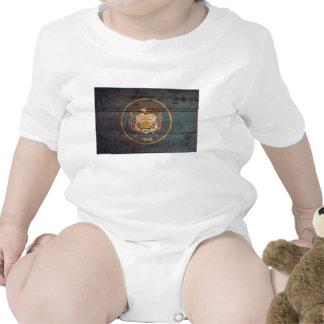 Old Wood Utah Flag Baby Bodysuit