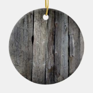 Old wooden background round ceramic decoration