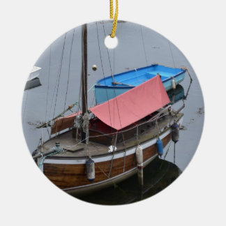 Old wooden yacht round ceramic decoration