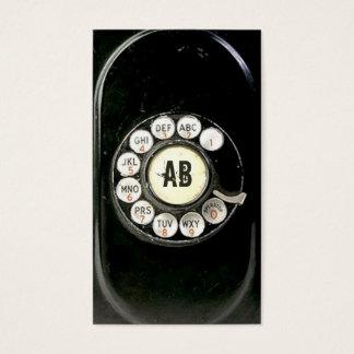 Old worn bakelite phone rotary dial Call me