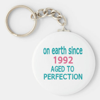 On earth since 1992 aged to perfection basic round button keychain