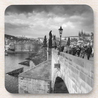 on the Charles Bridge under a stormy sky in Prague Coaster