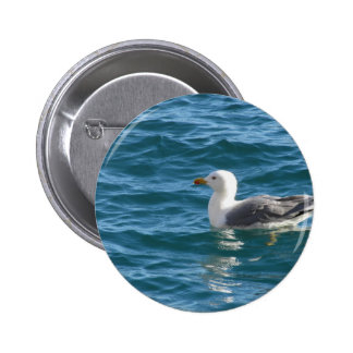 One seagull floating on the sea surface 6 cm round badge