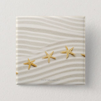 One unstraight row of starfishes 15 cm square badge