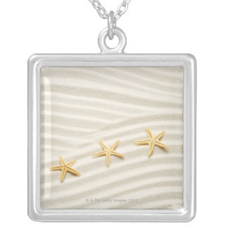 One unstraight row of starfishes silver plated necklace