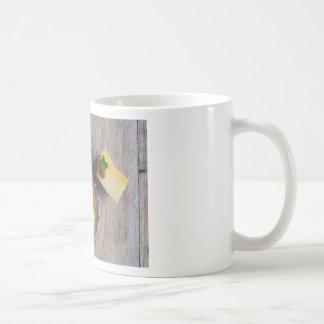 Onion pineapple chutney on rustic wood basic white mug
