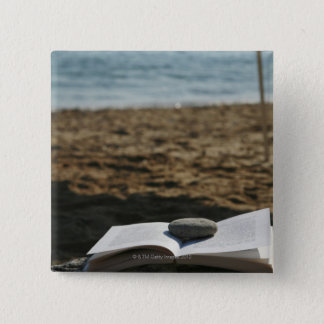 Open book with a roller 15 cm square badge
