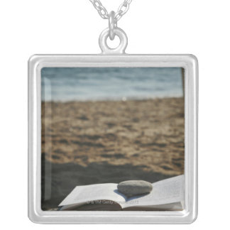 Open book with a roller square pendant necklace
