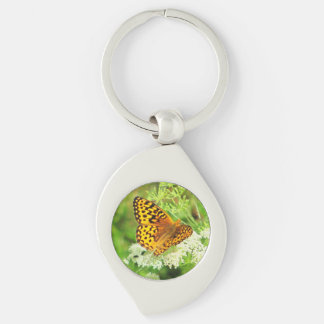 Orange and Black Butterfly on White Flower Silver-Colored Swirl Key Ring