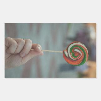 Orange and green lollipop rectangle sticker