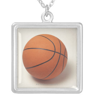 Orange basketball, close-up silver plated necklace
