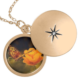 Orange butterfly with flower. gold plated necklace