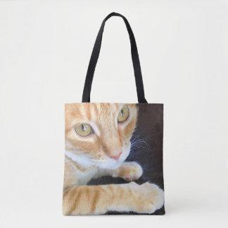 Orange cat closeup tote bag
