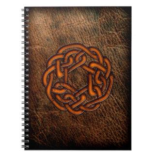 Orange celtic knot on leather notebook