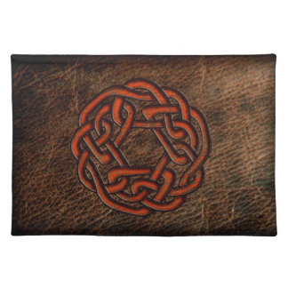 Orange celtic knot on leather placemat