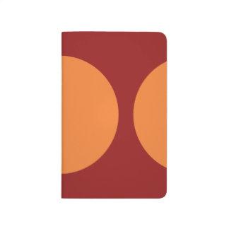Orange Circles on Red Journals