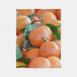 Orange clementines, tangerines wild duck green fleece blanket