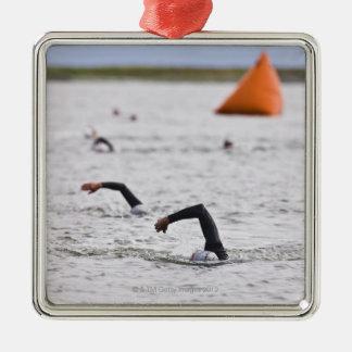 Orange course marker buoy. Silver-Colored square decoration