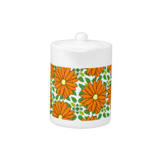 orange daisies on green leaves