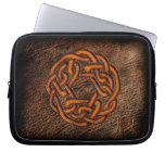 Orange enamel celtic knot on geniune leather computer sleeves