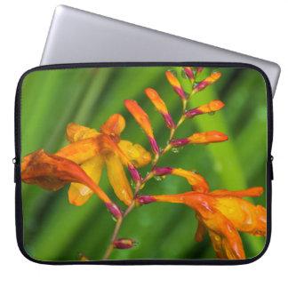 Orange flower after the rain laptop sleeve