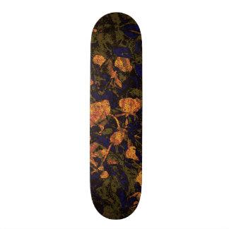 Orange flower against leaf camouflage pattern skate board