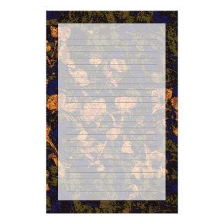 Orange flower against leaf camouflage pattern stationery paper