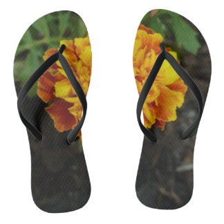 Orange flower dark background flip flops