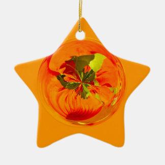 Orange flower in globe christmas ornament
