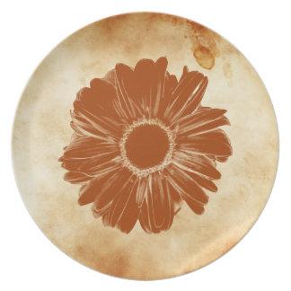Orange flower on grungy vintage paper plates
