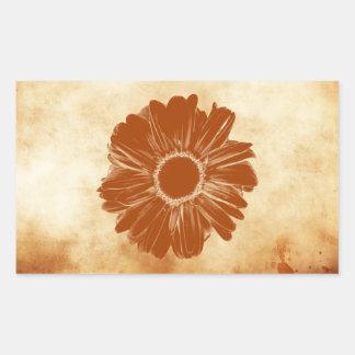 Orange flower on grungy vintage paper rectangle sticker