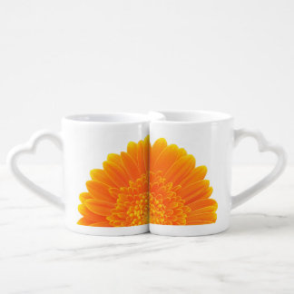 orange flower petals couples drinking mugs