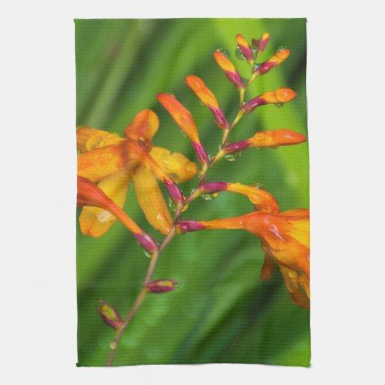Orange flowers after the rain kitchen towel