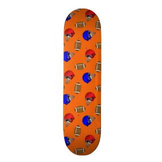 Orange footballs helmets pattern skate deck