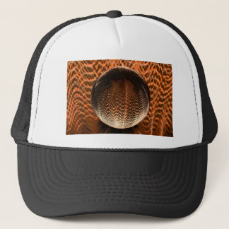 Orange in the crystal globe. trucker hat