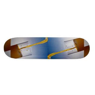 Orange juice poured into glass skateboard decks