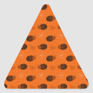 Orange ladybugs hearts bows pattern triangle sticker