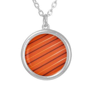 Orange metal corrugated sheet metal round pendant necklace