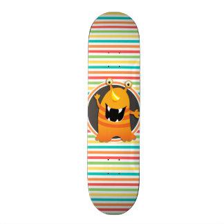 Orange Monster; Bright Rainbow Stripes Skateboard