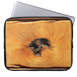 Orange natural wood with black hole and spiderweb laptop sleeve