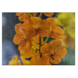 Orange orchids glass cutting board