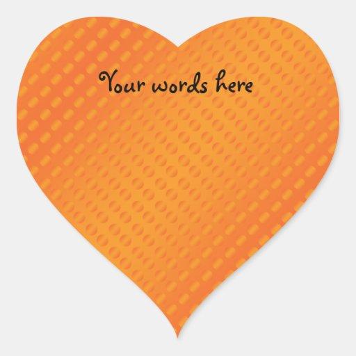 Orange polka dots on orange background heart sticker