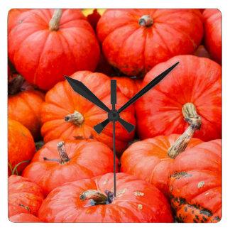 Orange pumpkins at market, Germany Clocks