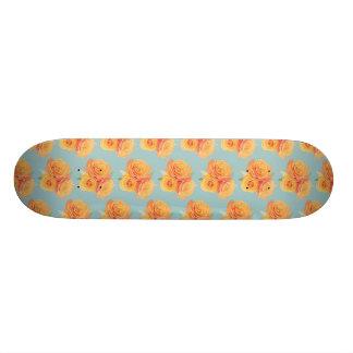 Orange roses on blue skateboard deck